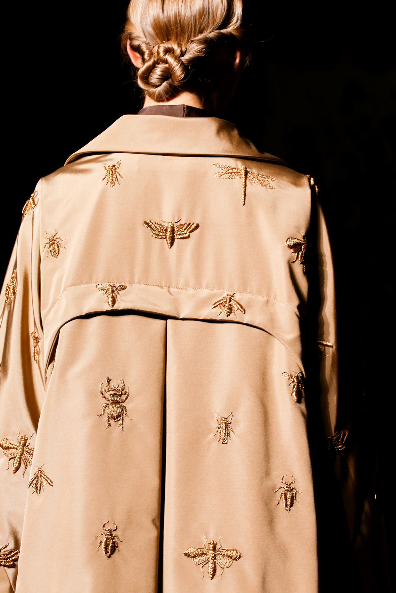 This smashing, insect-embroidered coat is part of the Valentino Fall 2013 couture line.