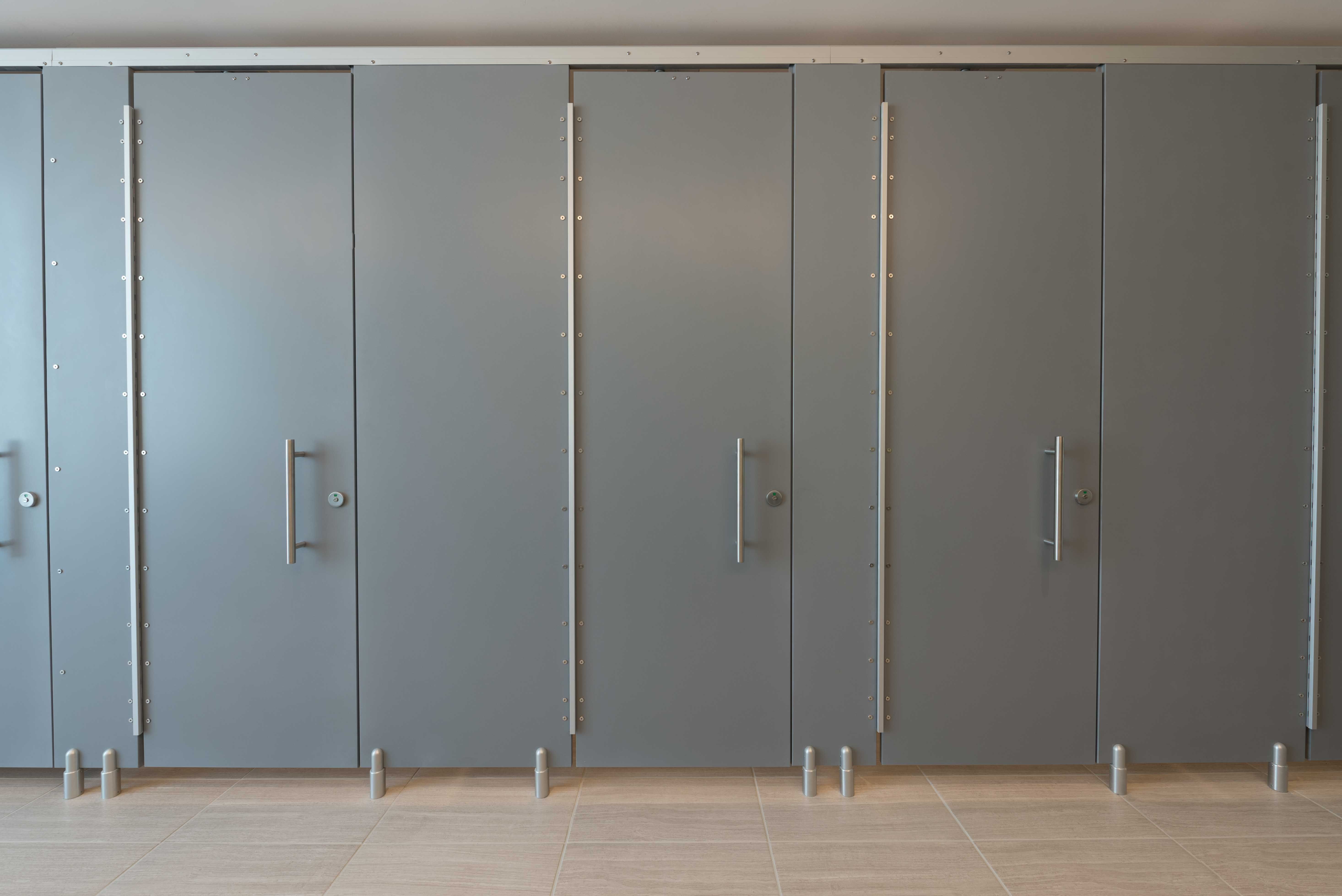 Ironwood Manufacturing Corian zero sightline bathroom doors and high privacy toilet partitions. Beautiful clean & Ironwood Manufacturing Corian zero sightline bathroom doors and ... pezcame.com