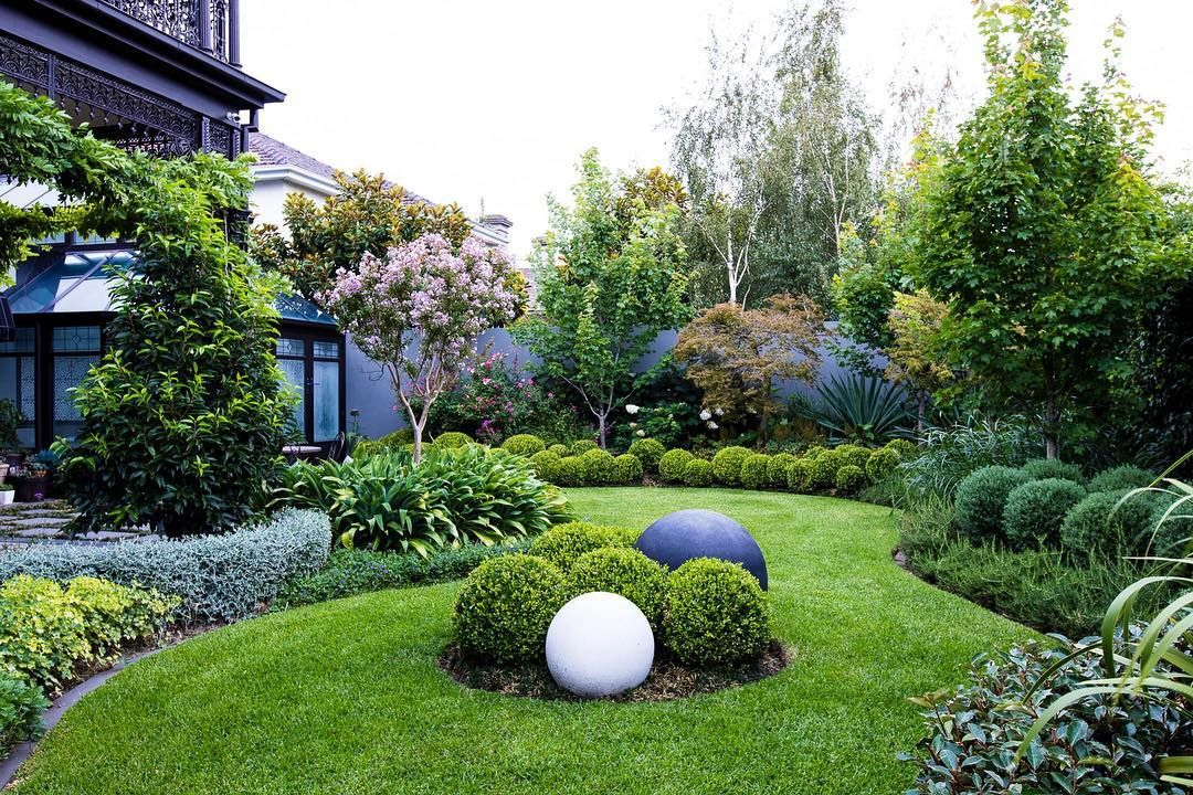 Curved Garden Beds Mass Plantings Of Rich Green Tones To Create