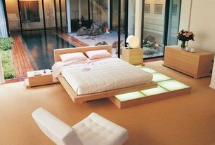 Contemporary Master Bedroom with Area rug, Hardwood floors, Roche Bobois Moonlight Bed