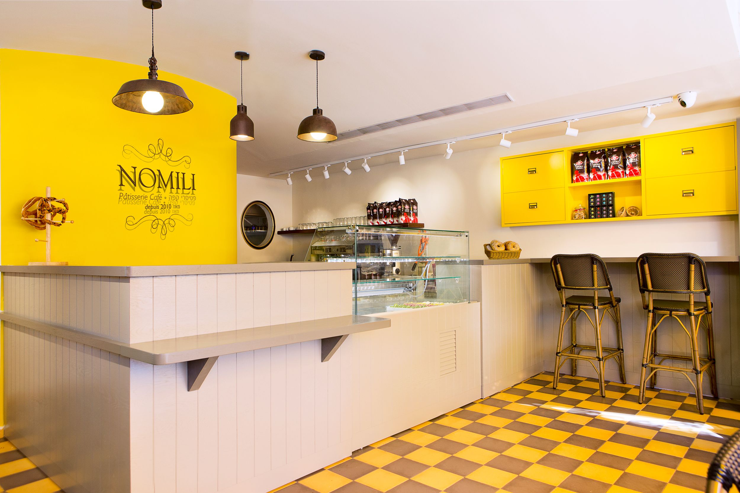 nomili Patisserie coffee shop designed by dana shaked yellow wall ...