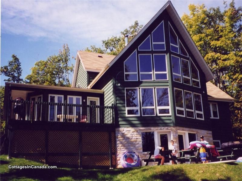 PL-10919: This year round executive style cottage offers a refuge for folks who seek a beautiful lakeside setting to unwind, but do not want to be spared any of the city  ...