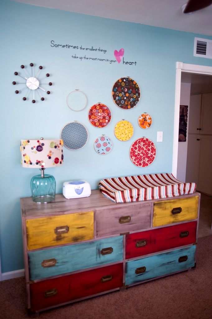 Colorful, vintage nursery dresser - love the pairing with the embroidery hoop wall art!