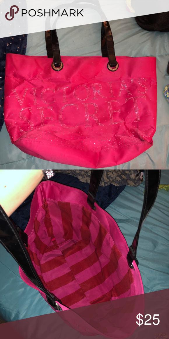 Victoria Secret Duffle Hot pink Victoria Secret duffle bag. Black straps 213410f43e0e0