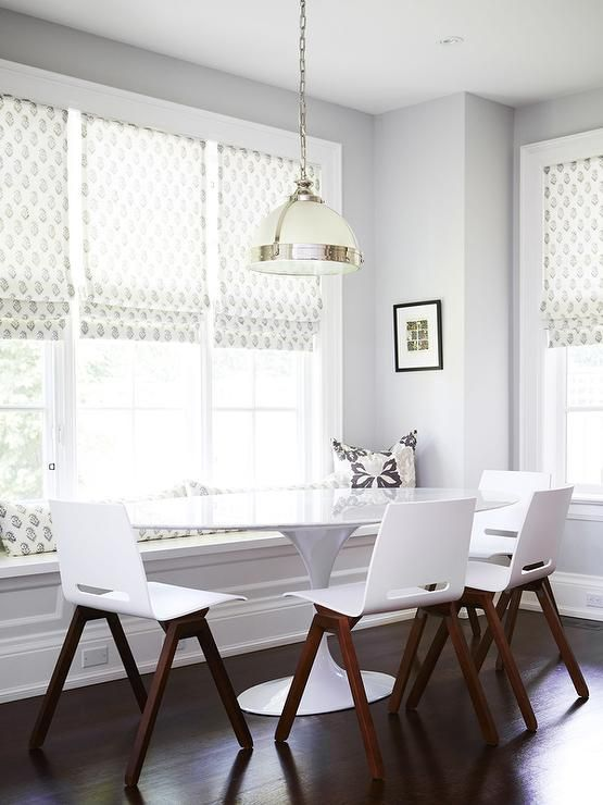 Chic Dining Room Boasts A Built In Window Seat Bench Facing An Oval Saarinen Table