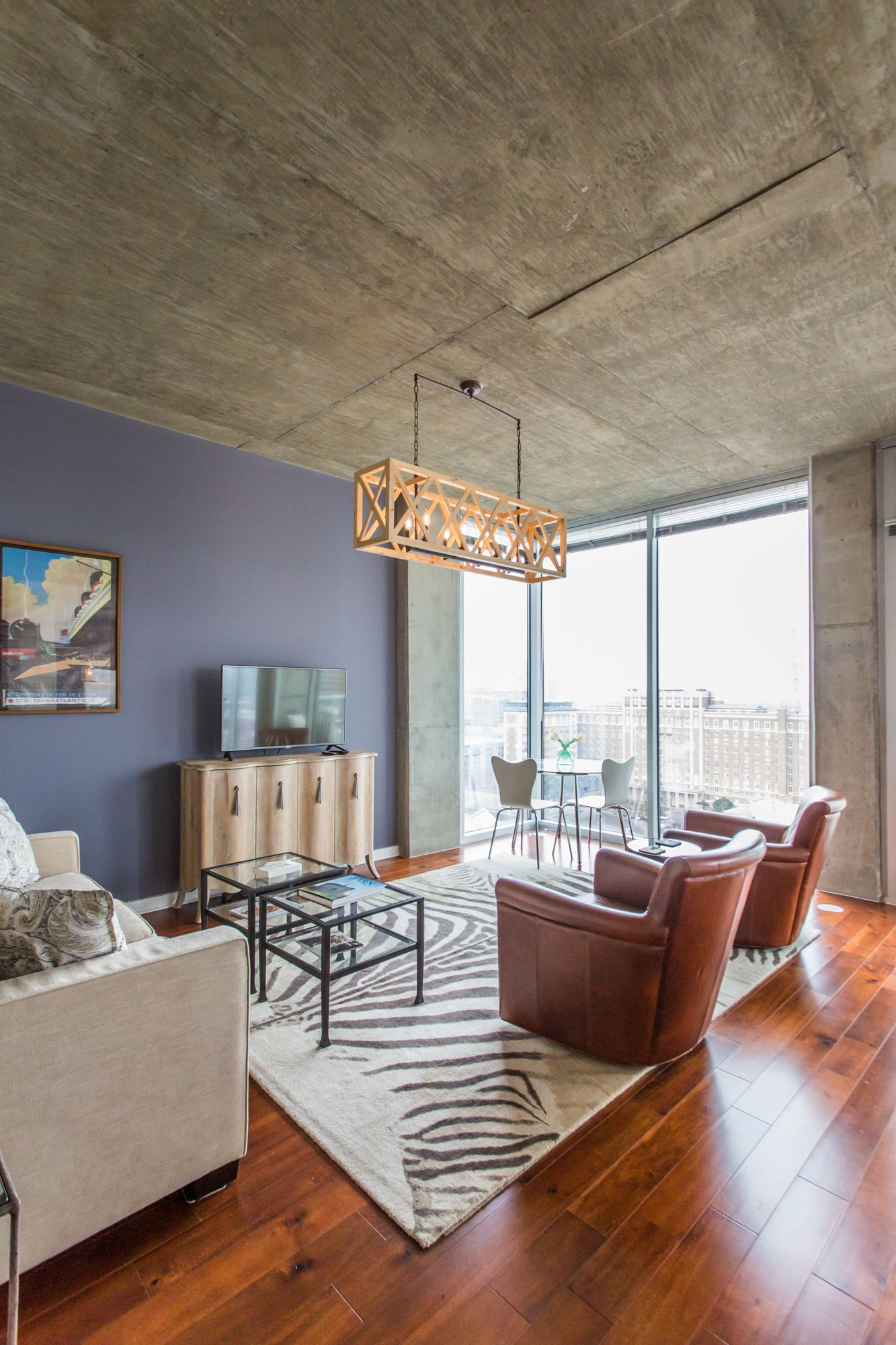 Cozy Leather Chairs And Warm Brazilian Cherry Floors Compliment The Concrete Ceilings And Floor To Ceiling Cherry Floors Brazilian Cherry Floors Leather Chair