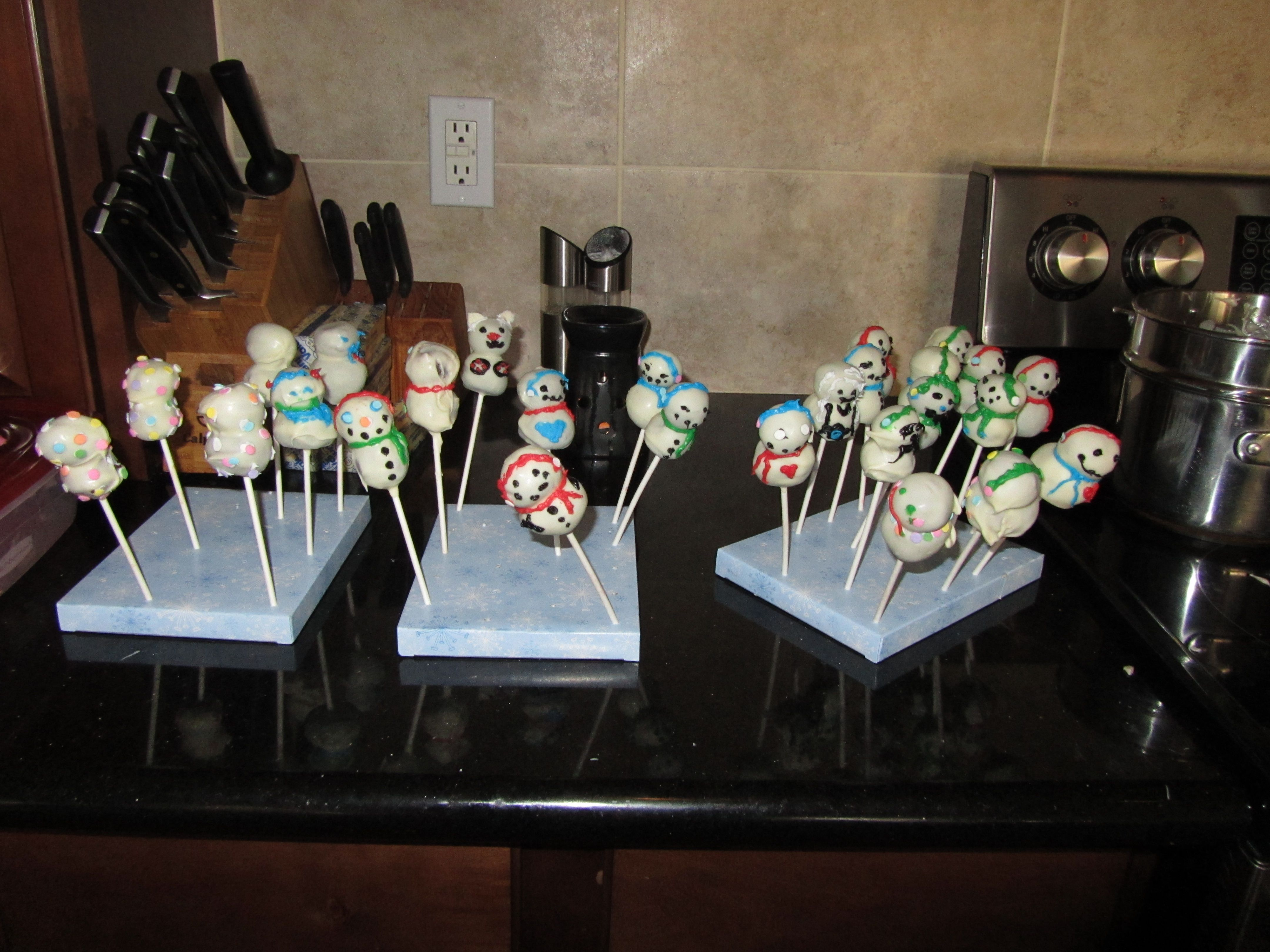 The kids helped me make snowman cake pops.