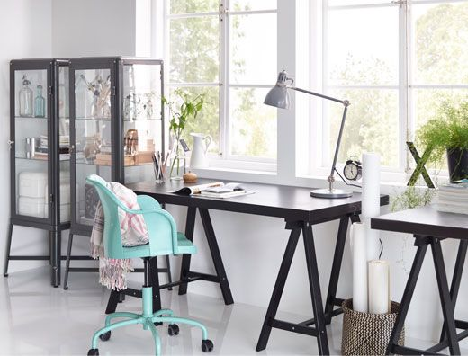 A home office with tornliden desk in black black fabrikÖr glass