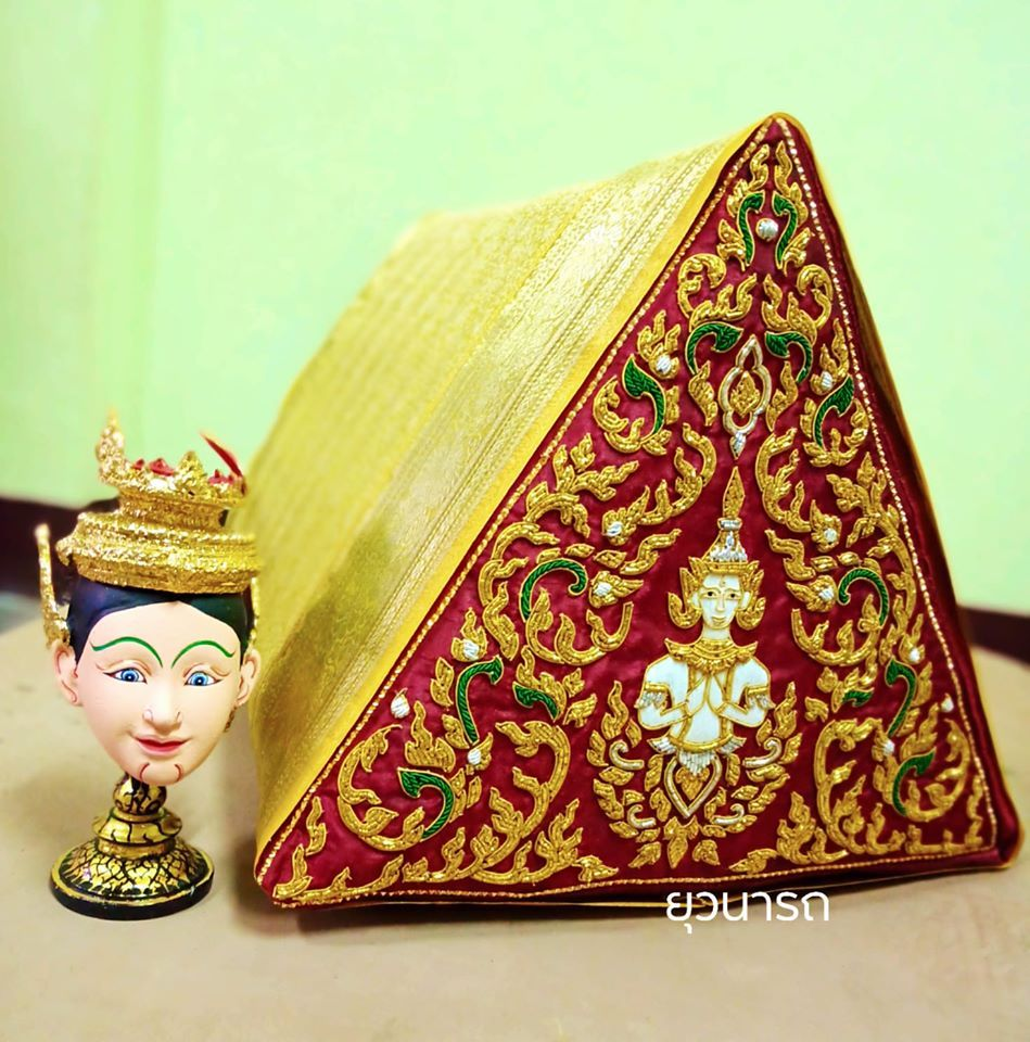 Thai goldwork embroidery on the triangle pillow. Credit: Looknum Yuwnarts(Facebook)  Thai goldwork embroidery is a handicraft inherited from the Ayutthaya period, which has been adopted from India and France to be modified into