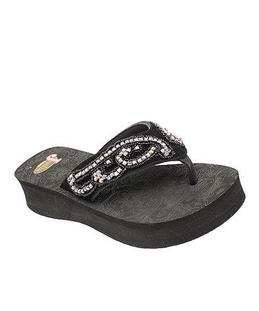 648dc6621 Take a look at this Black Cara Flip-Flop - Women by Justin Boots on  zulily  today!