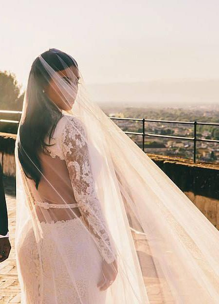 The most iconic wedding dresses of all time kardashian givenchy kim kardashian wore a couture wedding dress by givenchy boasting intricate lace long sleeves junglespirit Image collections