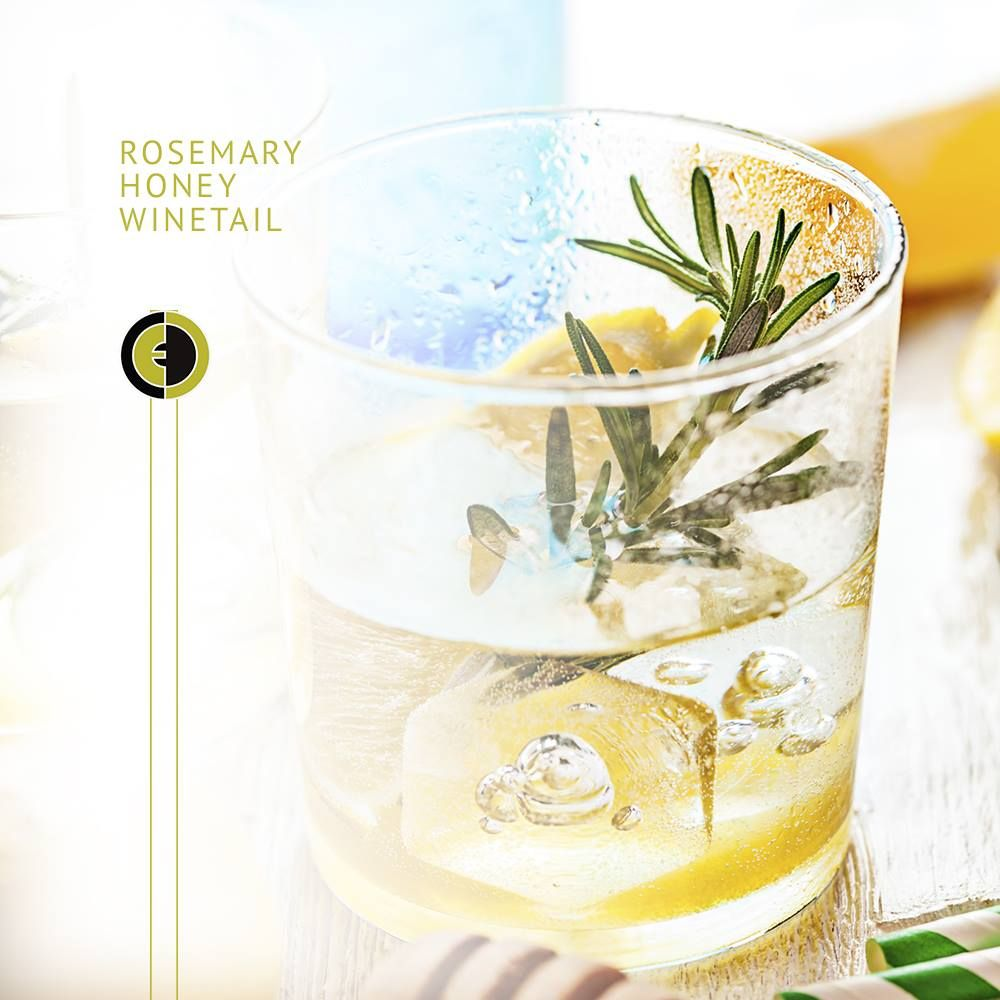 Our Rosemary Honey wine cocktail will add a touch of sweetness to your Wine Wednesday! #WineWednesday #Summer #EccoDomani #Honey #Rosemary Ingredients: 3 ounces of Ecco Domani Pinot Grigio, 1-1/2 ounce Lemonade, 1/4 ounce Honey, Rosemary Spring & Lemon Wedges Garnish