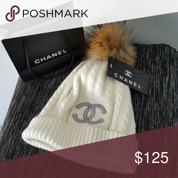 254b48d2aa4 Chanel cashmere hat New Chanel cashmere hat. Rabbit fur pom pom. On Merc  for half my listed price on this spp. Last 3 letters are ari. First 4 are  Merc.