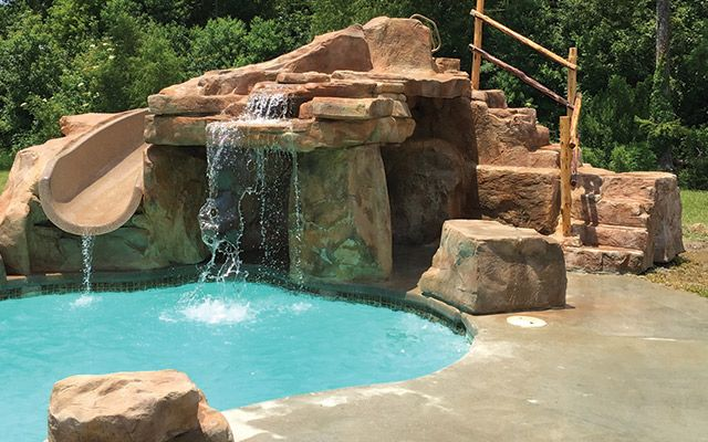 Why Caves And Grottos Are Easy Profitable Pool Add Ons Pool Water Features Pool Waterfall Grotto Pool