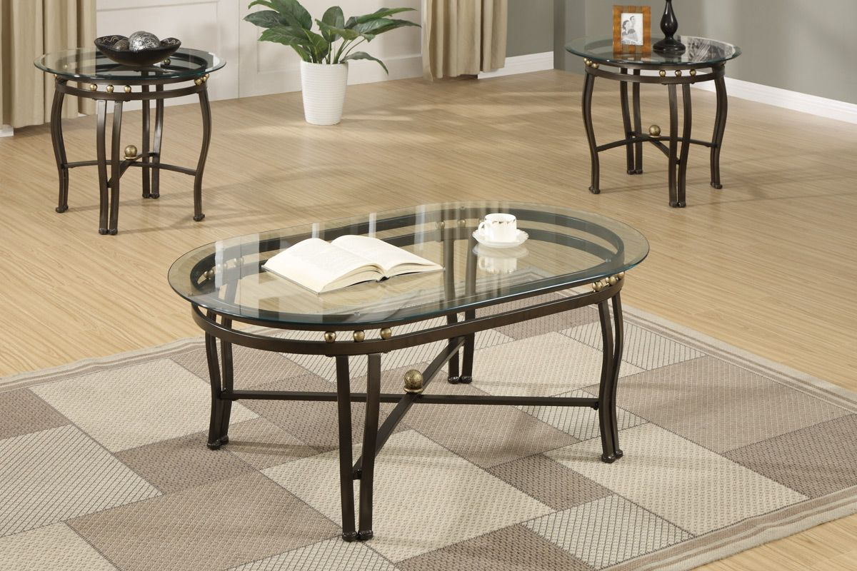 A timeless piece of living room furniture this coffee table features clear glass beveled oval shaped tape tops with dark bronze finished metal base and