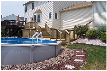 An Above Ground Pool Deck Offers Outdoor Living Above Ground