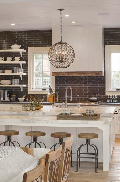 Dark Subway Tile Backsplash Extended To Ceiling White Countertops And Cabinets Open Shelving Wood Metal Stools