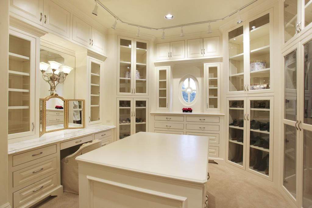 Walk In Master Closets With Abundant Fitted Storage Vanity Space And Custom Lighting