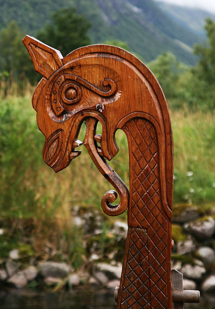 From A Viking Ships Front The Traditional Wooden Dragon