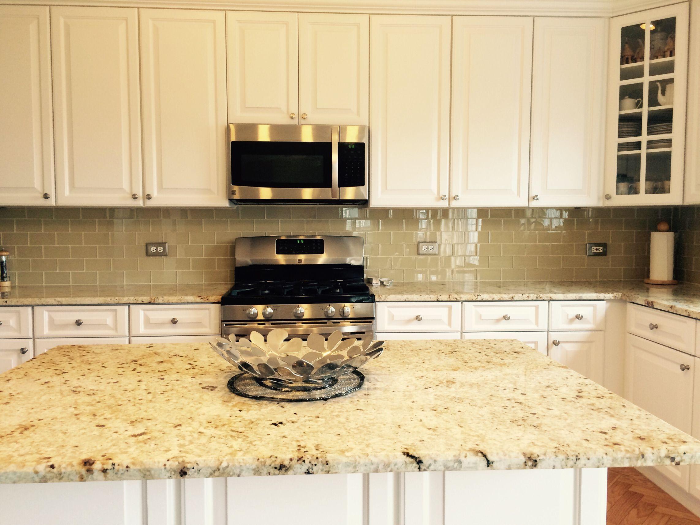 Khaki glass tile kitchen backsplash with white cabinets  granite also subway pinterest
