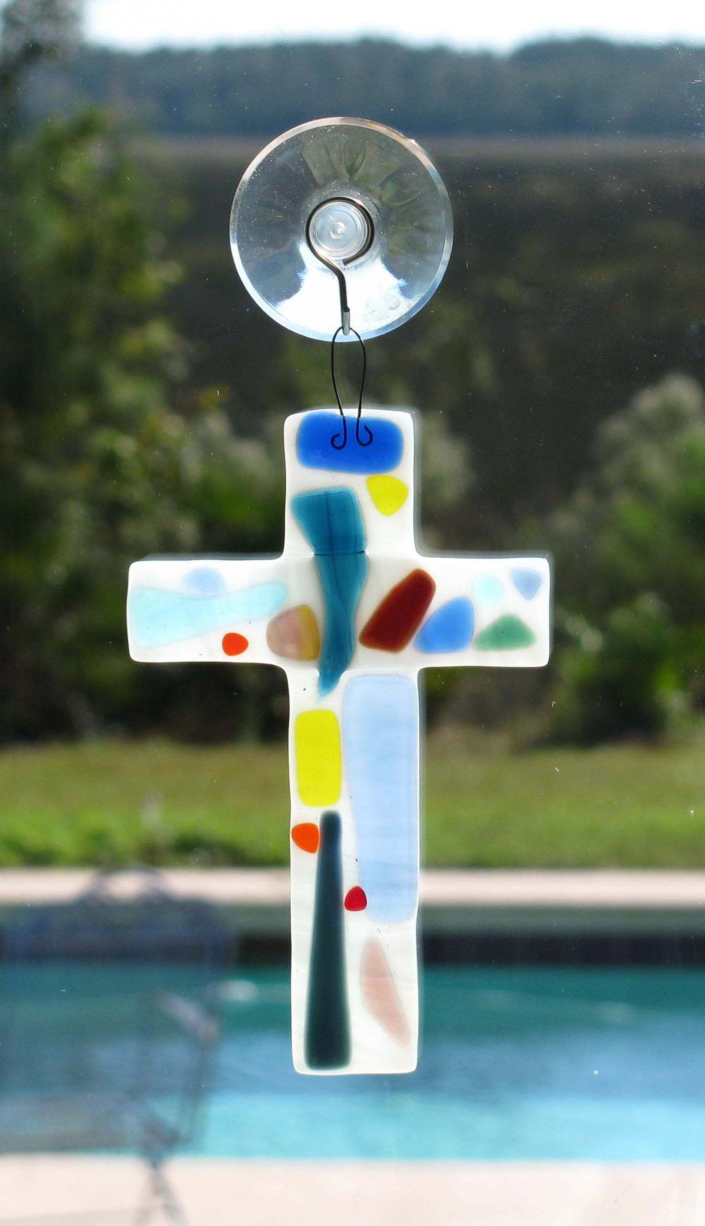 Fused glass cross with assorted colors.