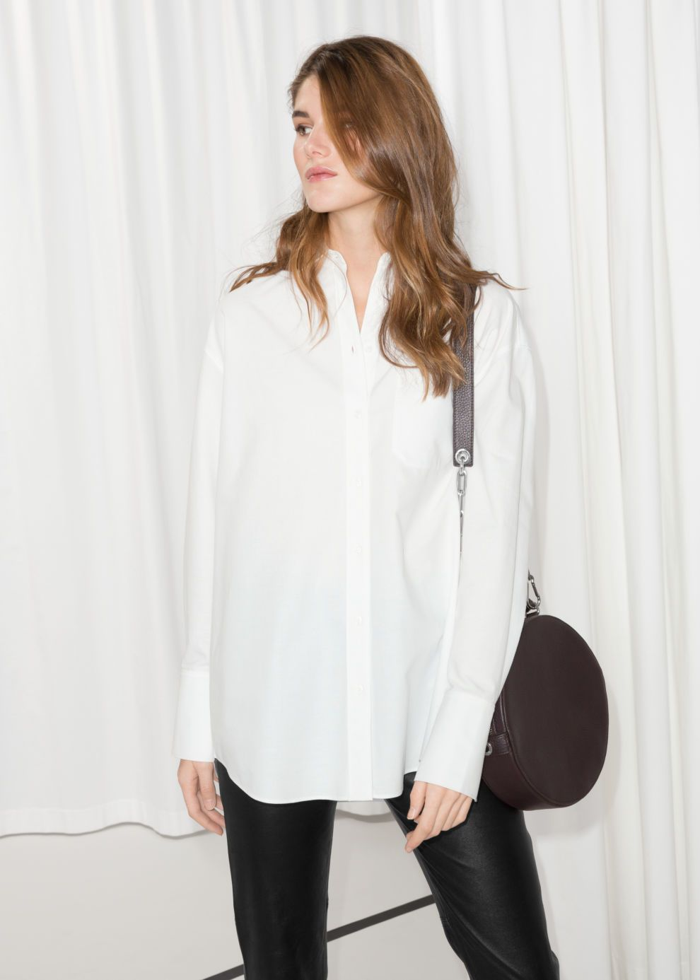 b5006a130 Model front image of Stories oversized button down shirt in white