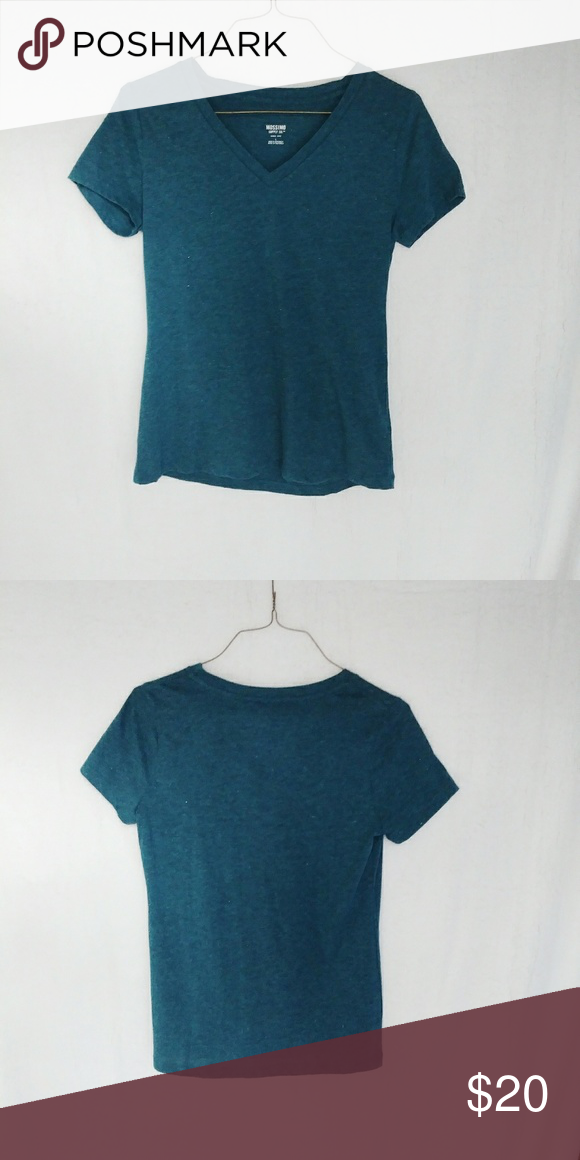 60ca9bc4 Mossimo Shimmer V-Neck Tee V-Neck tee with shimmer detail here and there with  a dark teal color Mossimo Supply Co. Tops Tees - Short Sleeve