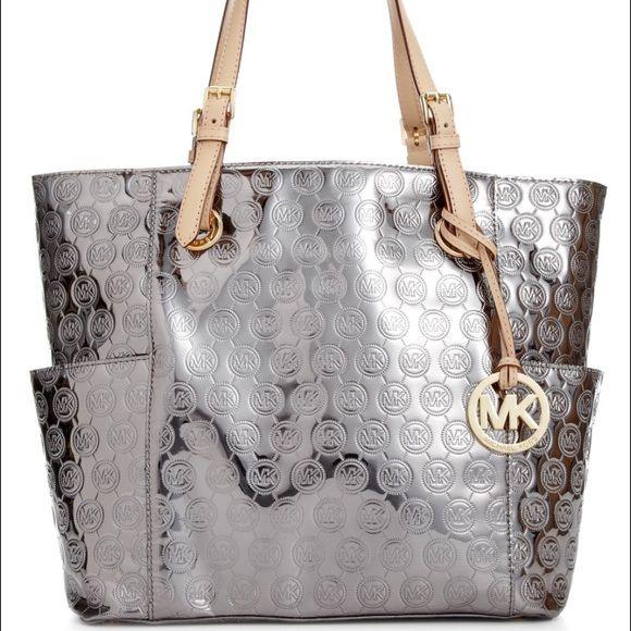 e112743dac09 Michael Kors Bag Grey Silver MK bag tote with tan strap handles and side  pockets. Michael Kors Bags Totes