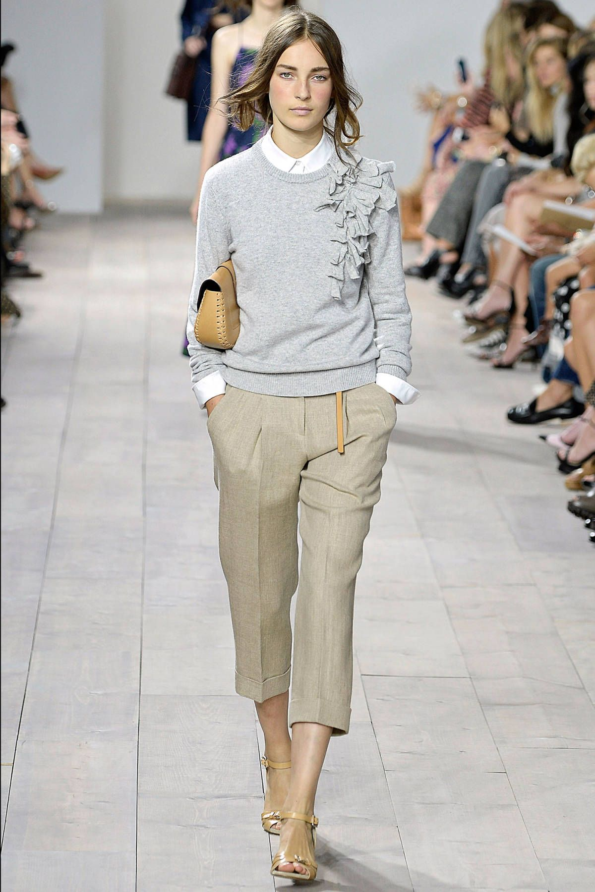 Easy, luxe and all American. Oh, and cheerful. Michael Kors is at his best when he serves up his classic, clean sportswear. His ethos? Life is short, so why all the tricks? Effortless dressing is where it's at.    - HarpersBAZAAR.com