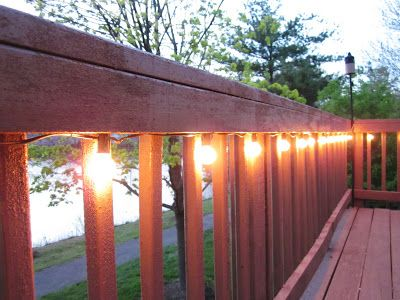 Diy Home Improvement Project For This Summer Lighting The Deck Using Cafe Lights Stapled To Handrail
