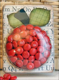 Cute idea for a teacher  used one of the Buttons & Bling containers...re-purpose, re-use, recycle....be sure to clean and air out the container before filling it with candy.  And if not M & M's then maybe some red wrapped cinnamon hard candies.