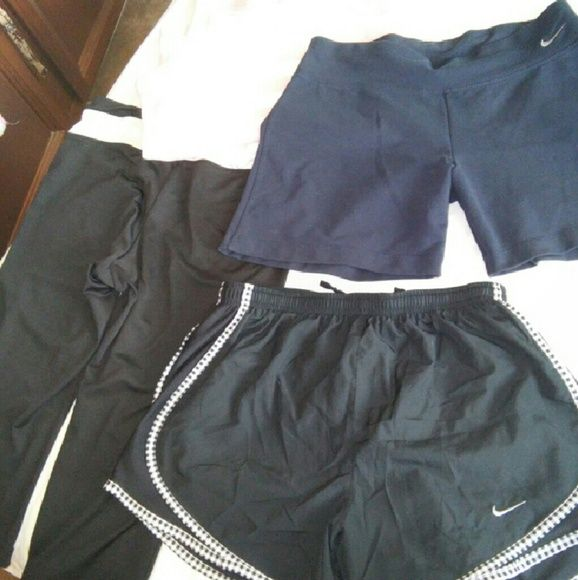 BUNDLE BUNDLE BUNDLE The Perfect Workout bundle two pairs of Nike shorts in size small one pair of FILA workout caprissize small  in black and white and a pink and white Nike tank top Nike Shorts
