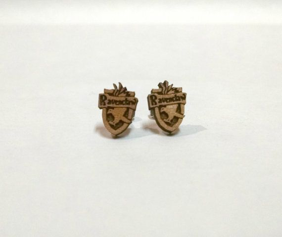 Ravenclaw crest earrings. This shop has all four houses, plus the Hogwarts crest and the deathly hallows symbol!