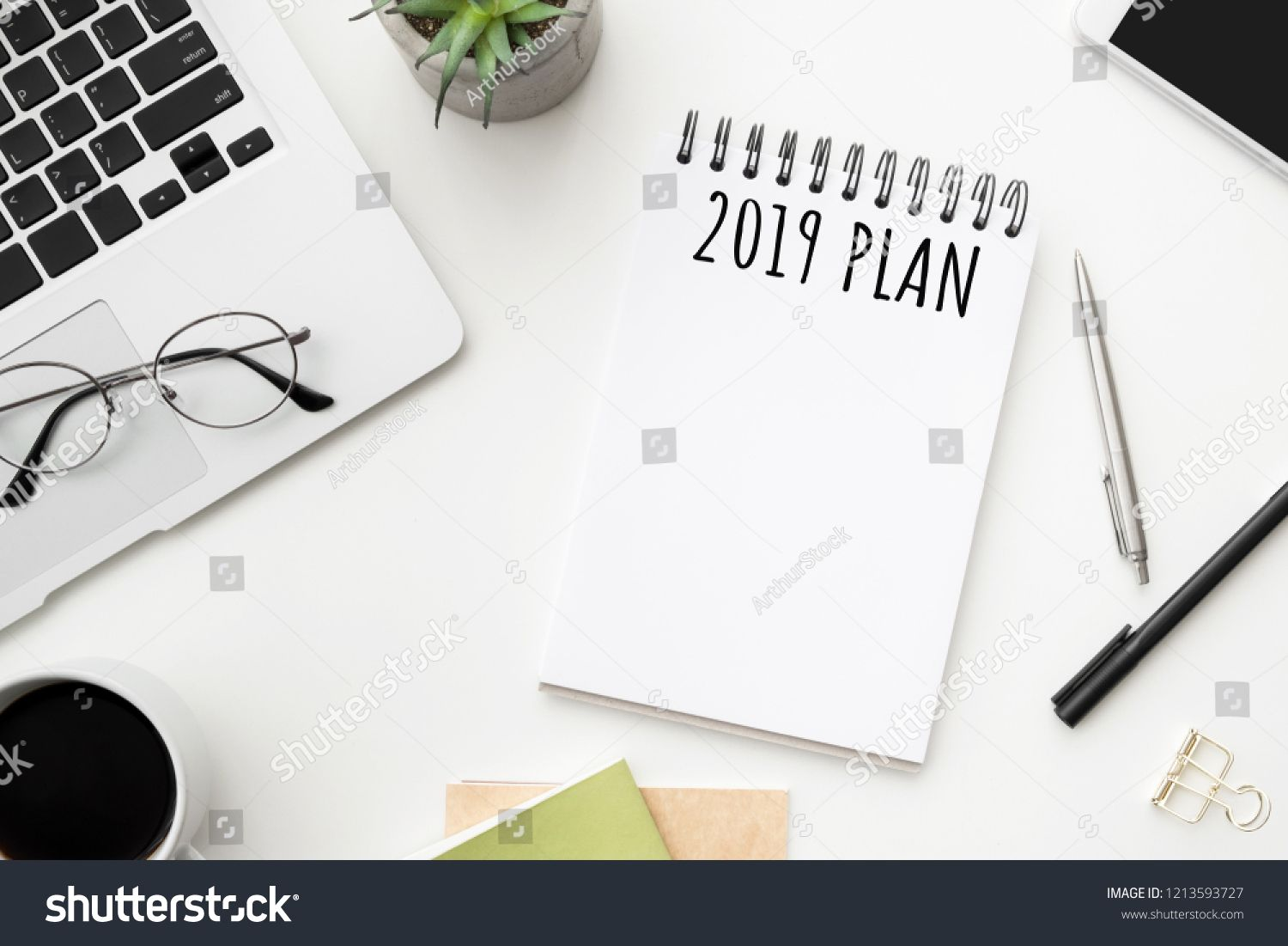 Notebook Page With 2019 Plan Text On White Office Desk Table Top