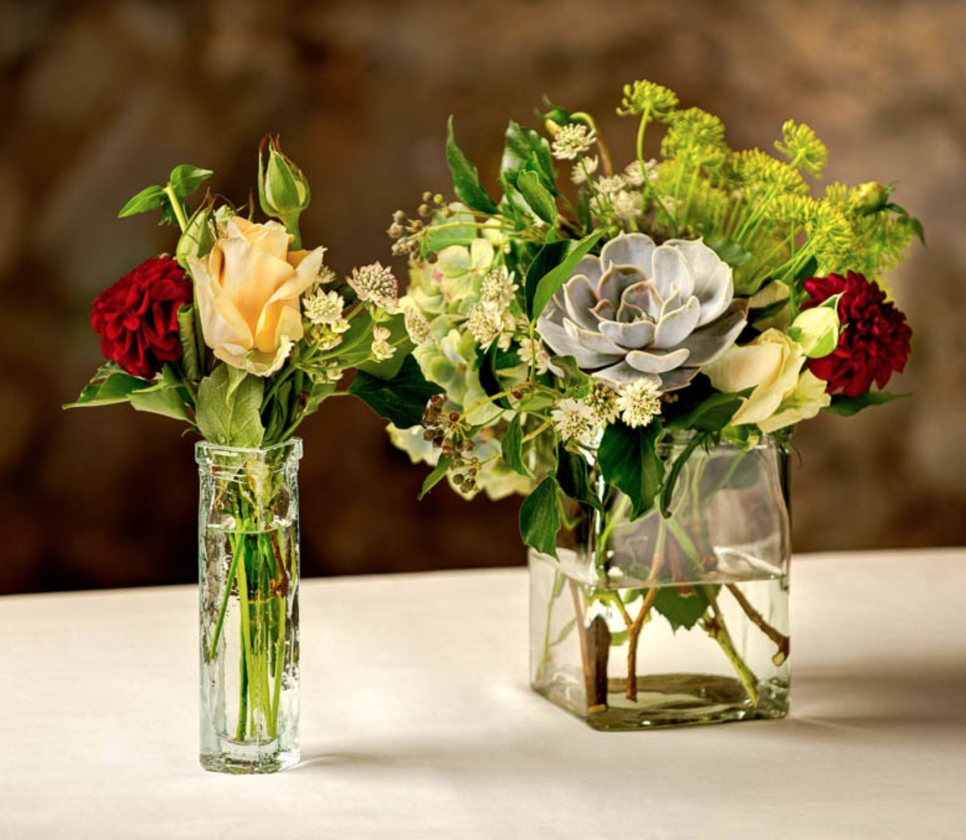 The perfect arrangement of flowers in the perfect vases.