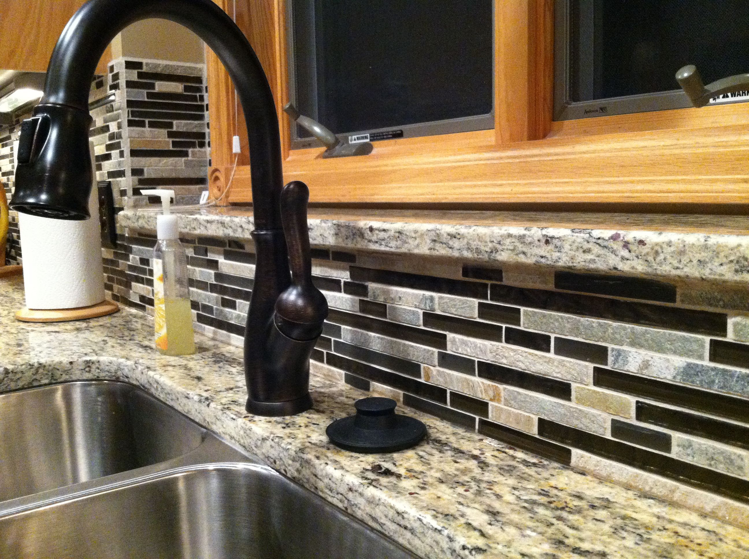 Delta Oil Rubbed Bronze Faucet Backsplash Is Glass And Stone   MC Pacific  Foil/Slate