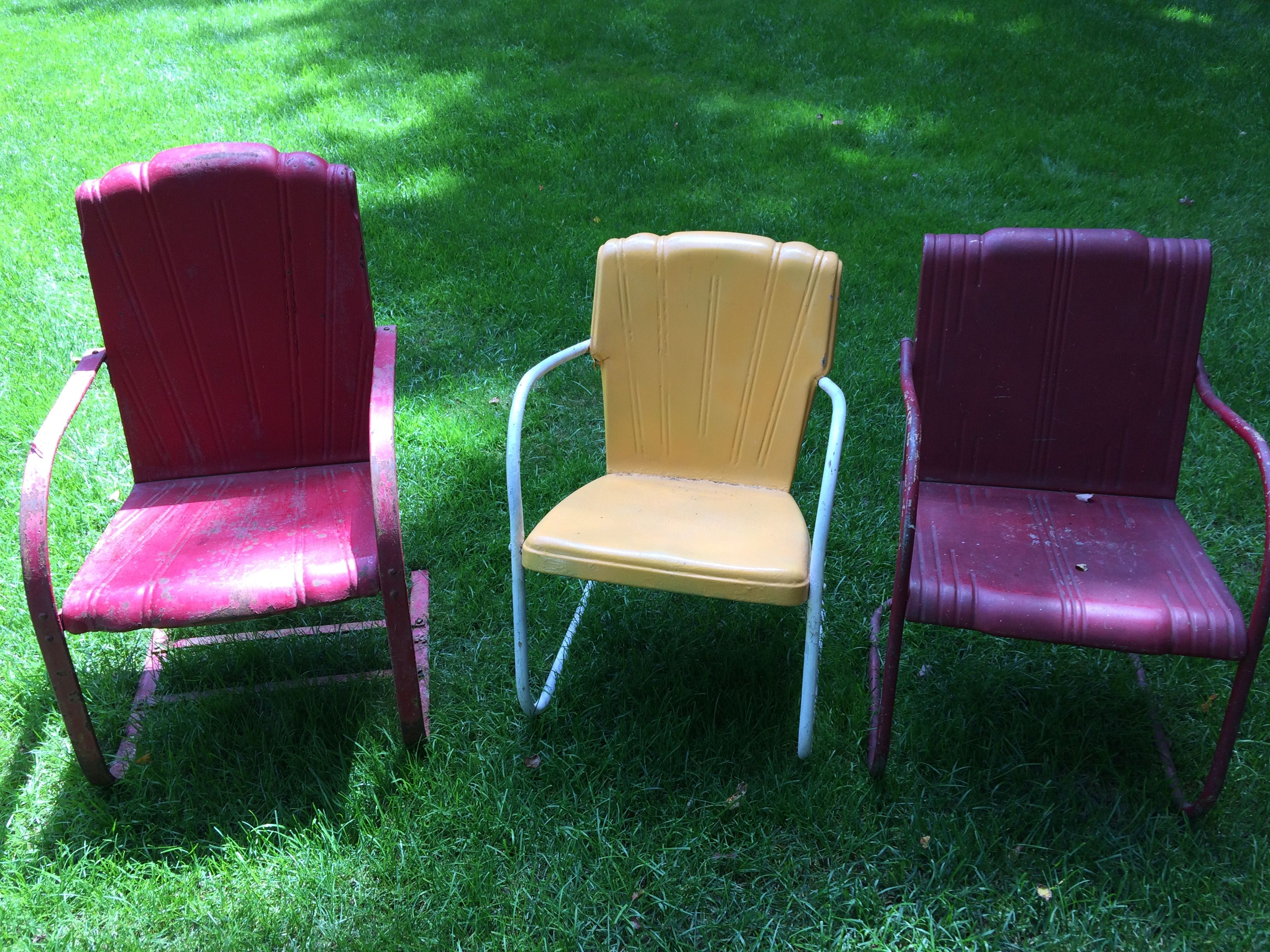 Right chair is a Harry Kranz designed 1938 vintage metal lawn