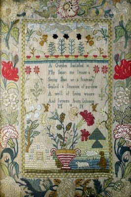 George III needlework sampler, initialled MN, dated 1773 and unusually dated with one number of the year in each corner of the main panel.