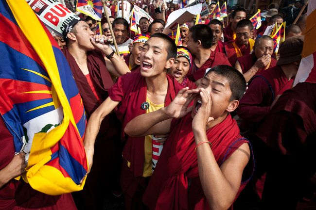 Tibetan monks protest China's rule.