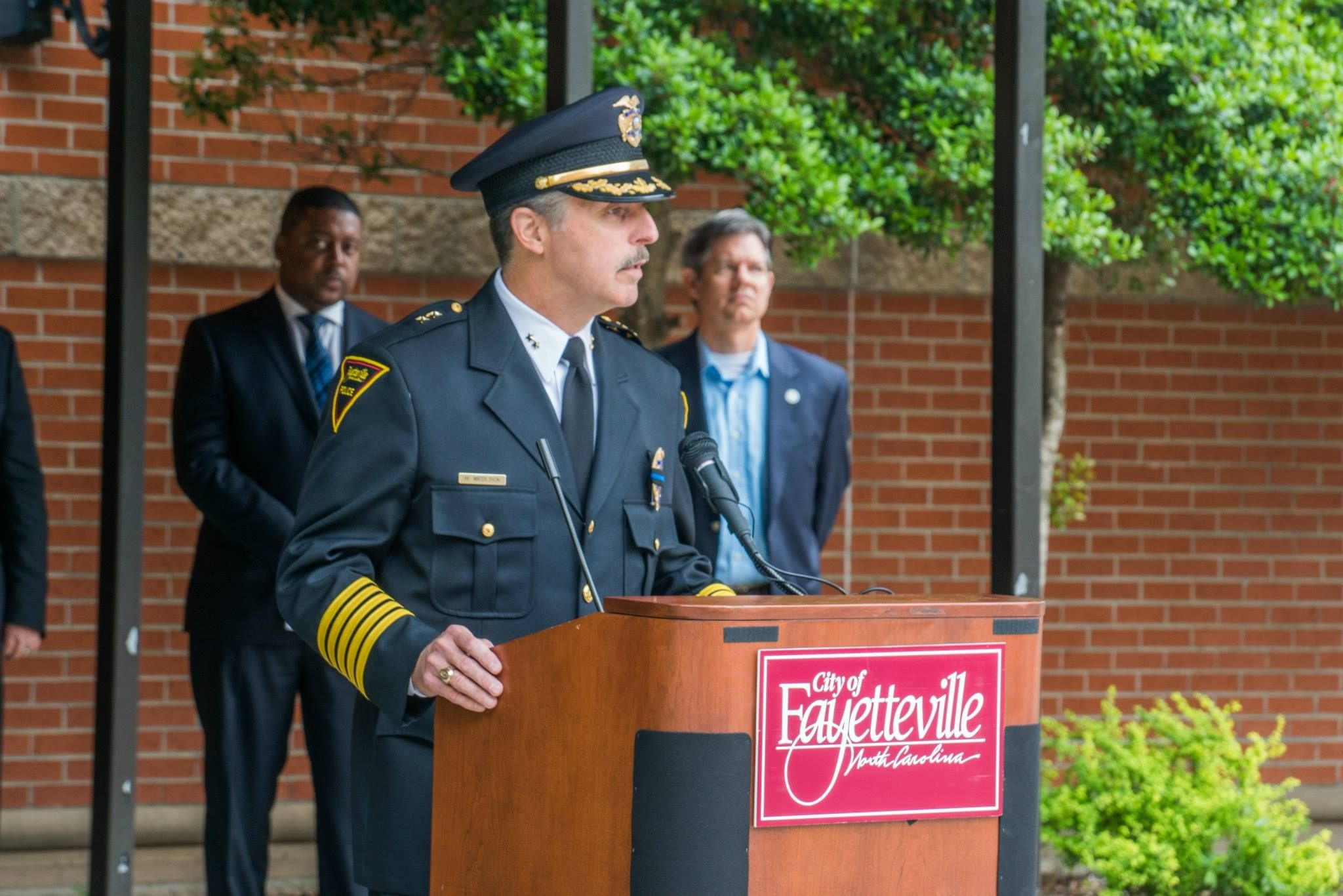 During The 2015 Fallen Officer Remembrance Ceremony Policechiefharoldmedlock And The Fayettevillepol Police Chief Fallen Officer Police Department