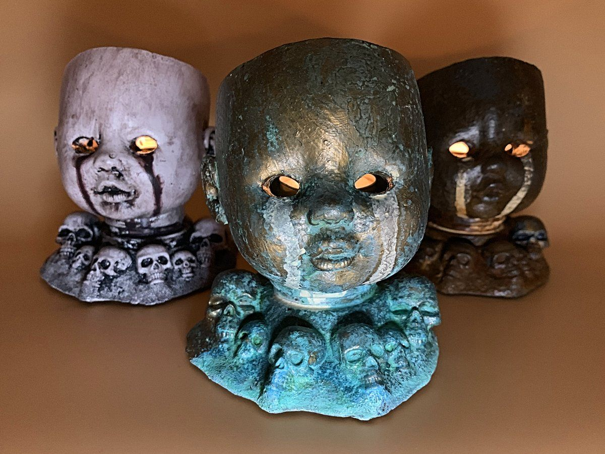 Baby doll head candle holder
