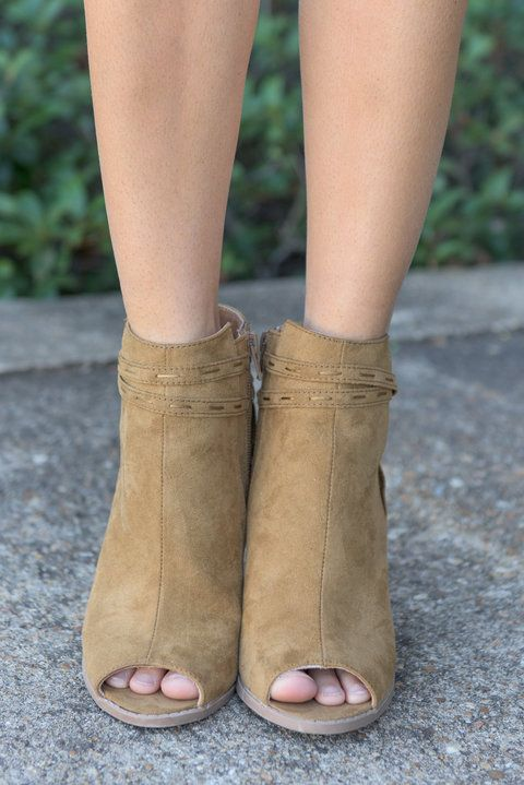 """""""Fab Following Booties, Tan"""" These chic little booties already have a pretty fab following around here! We're all not only obsessed with the straps and tassel details but also the color! #newarrivals #shopthemint"""