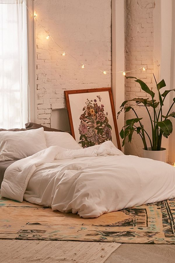 faded ribbed jersey comforter  mattress on floor urban