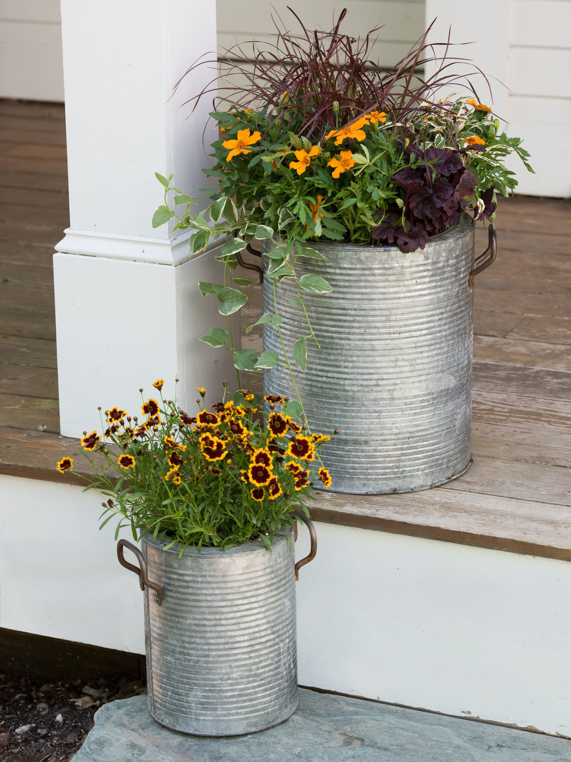 Galvanized Metal Planters With A Rim And Handles Gardeners Com Barrel Planter Metal Planters Planters
