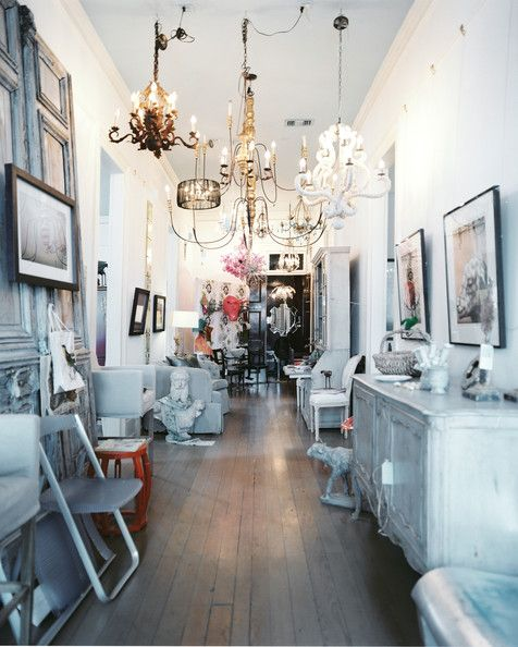 Eclectic Retail Store Design   A Gathering Of Chandeliers Hung Above  Neutral Home Accessories