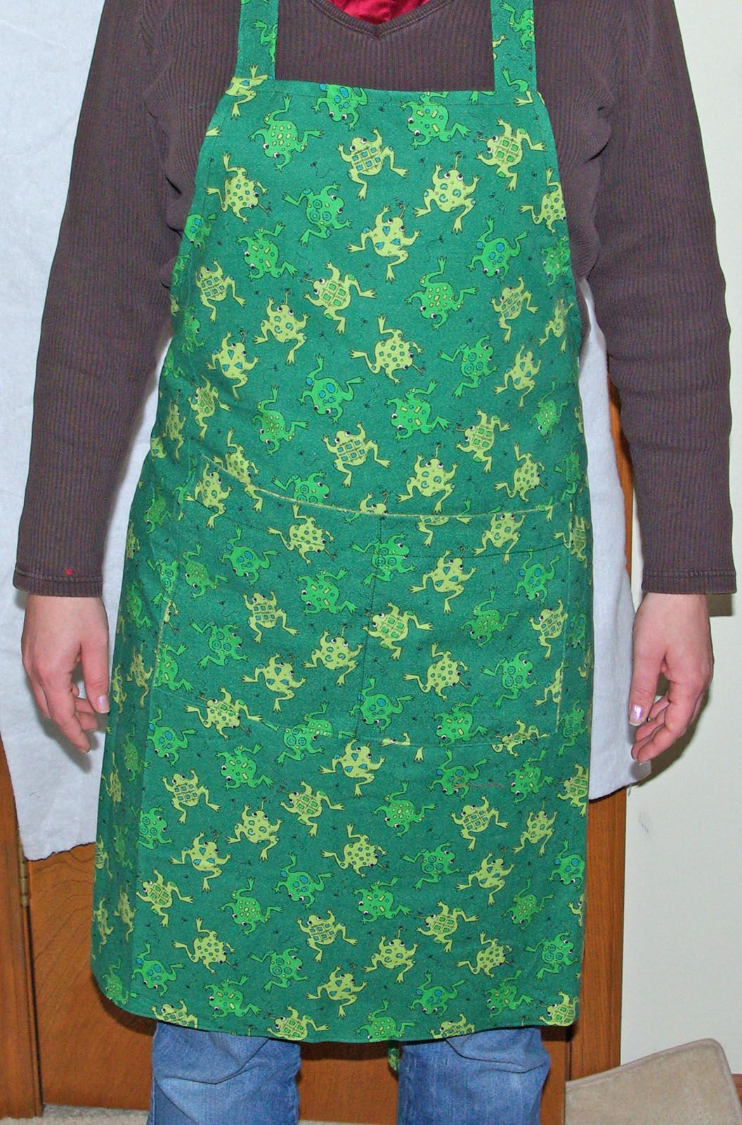 Frog Apron will fit most women.  $20.00 with FREE shipping and FREE personalization from www.AGiftToTreasure.com