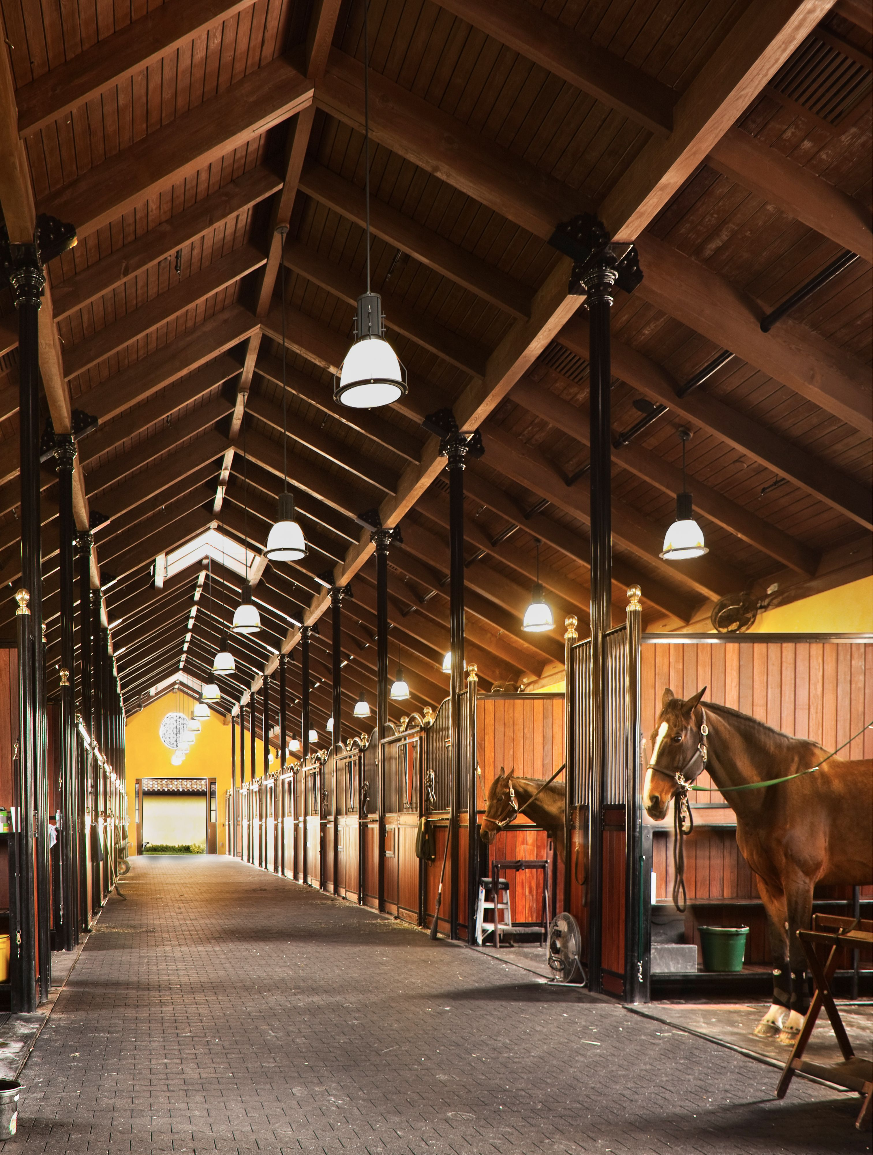 Horse stable where we designed the stalls to be integral for Horse farm design