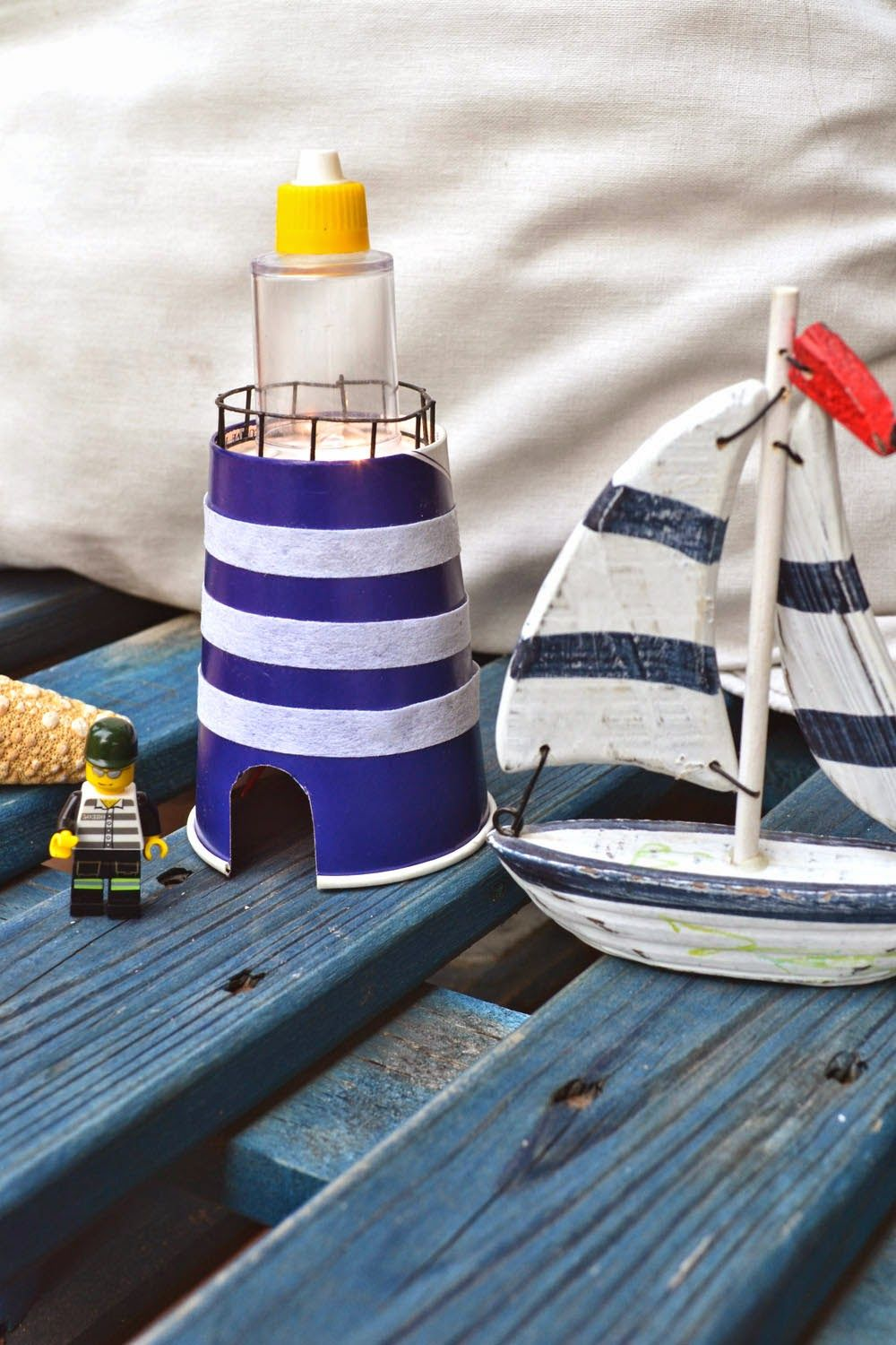 With a paper cup lighthouse cups and craft mommo design with a paper cup jeuxipadfo Image collections