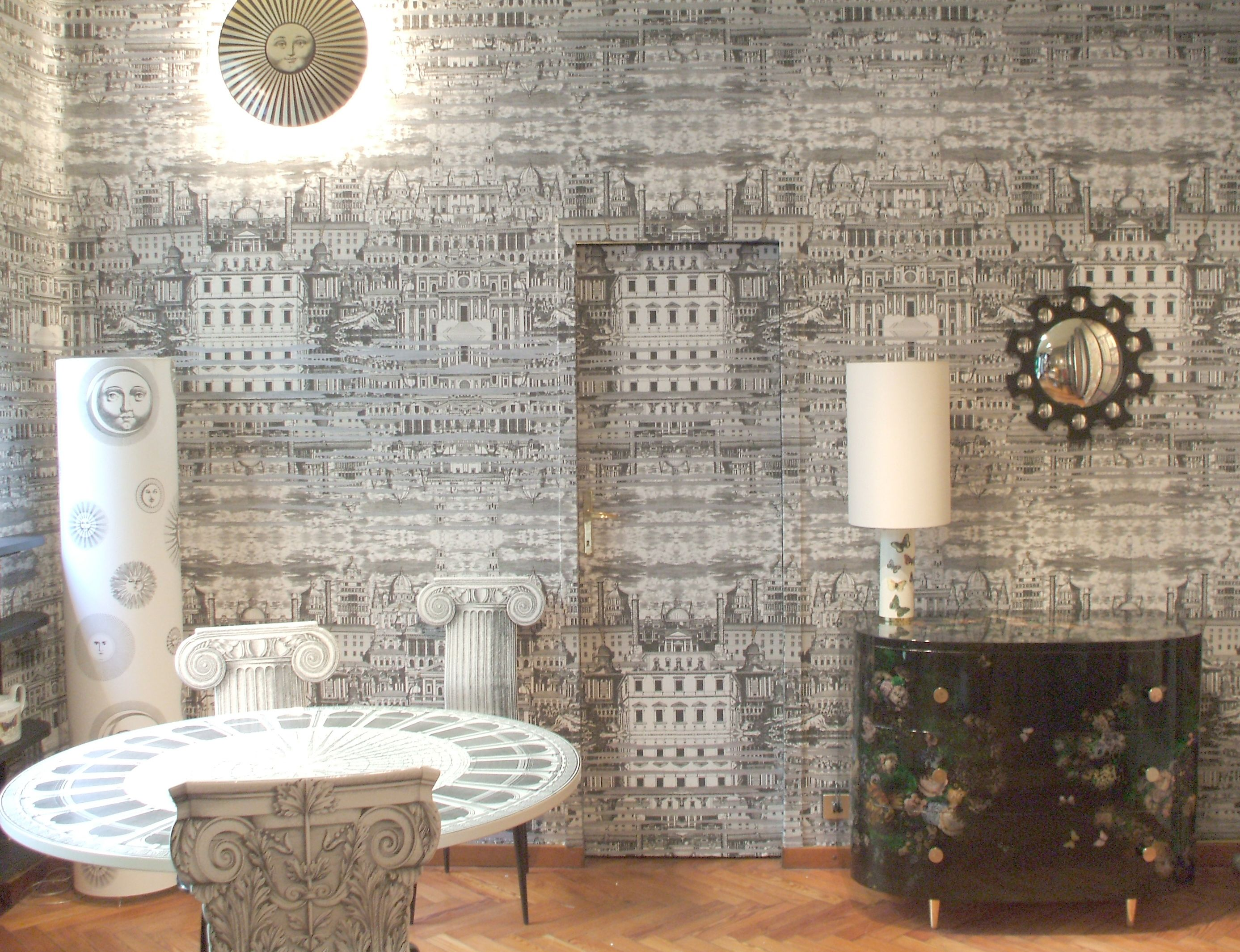 Fornasetti Riflesso in Milan showroom. Wallpaper by Cole