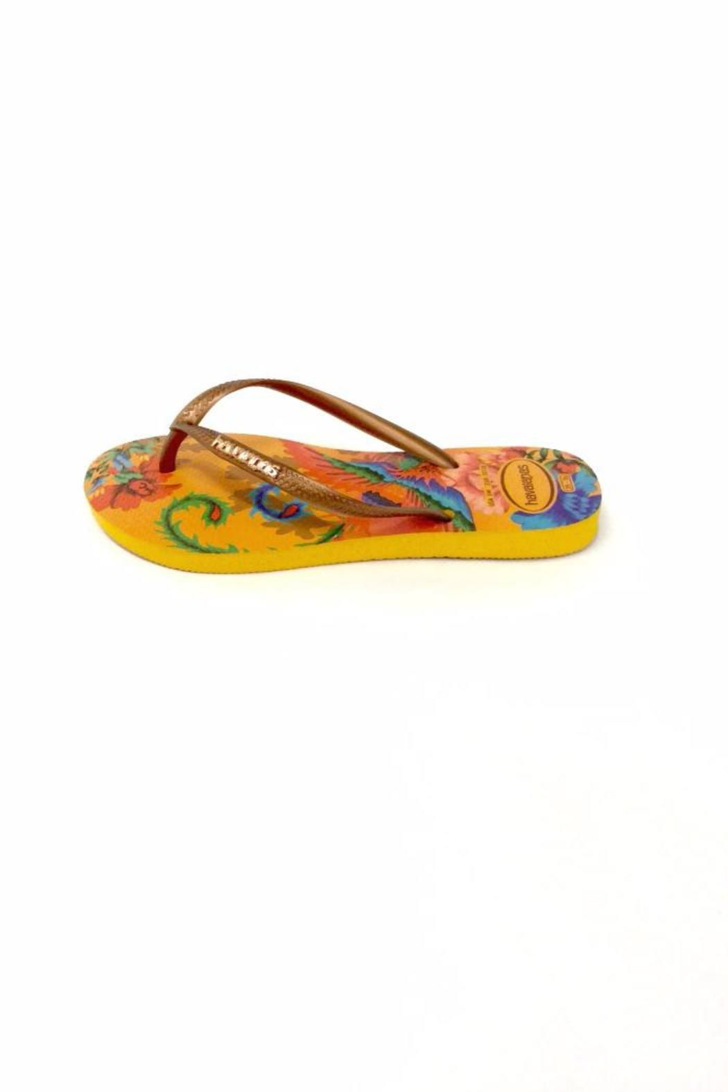 1b24a7b4edd6c3 The Slim Tropical features prints inspired by the phoenix and lotus flower on  Havaianas signature textured footbed for style and comfort.